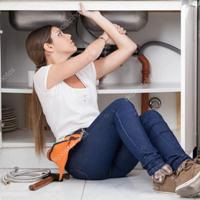 depositphotos_86708340-stock-photo-plumber-woman-repairing-the-pipe.jpg